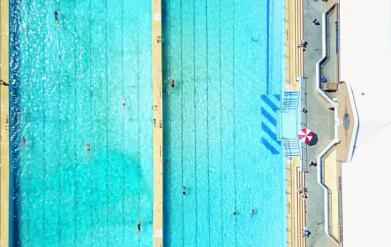 Aerial view of swimming pool during sunny day