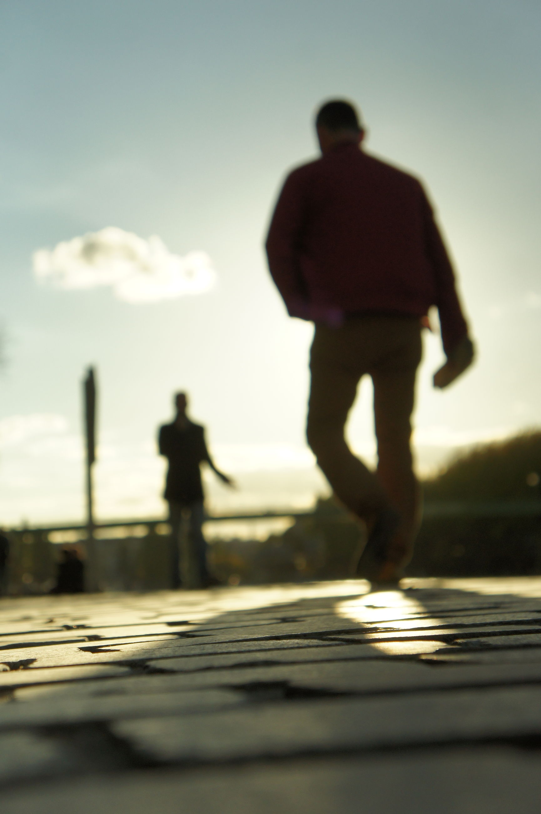 silhouette, focus on foreground, men, lifestyles, leisure activity, photography themes, selective focus, photographing, built structure, sky, holding, building exterior, architecture, outdoors, technology, unrecognizable person, camera - photographic equipment