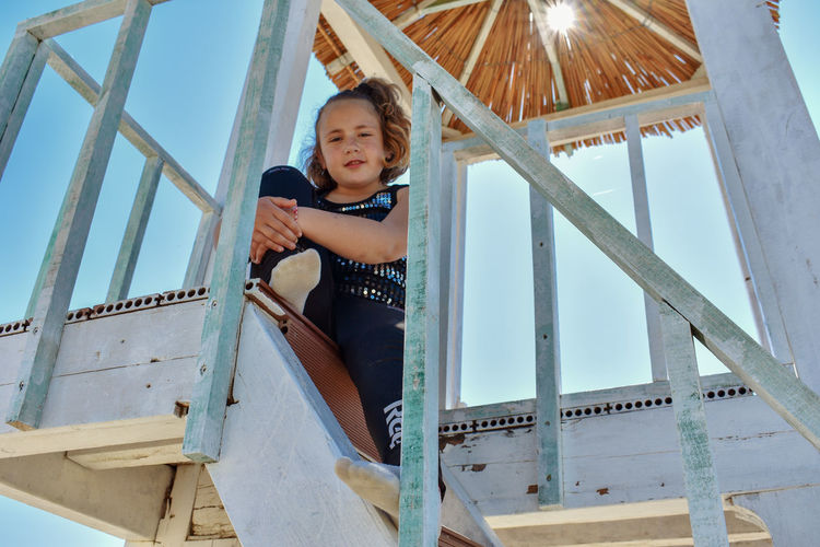 Sunny Day Wooden Structure One Little Cutie Posing For The Camera Sitting Pretty Sitting On A Bench Stairs_steps Child Childhood Boys Portrait Full Length Males  Beach Girls Sky Lifeguard Hut Lifeguard  Lookout Tower Shore The Portraitist - 2019 EyeEm Awards