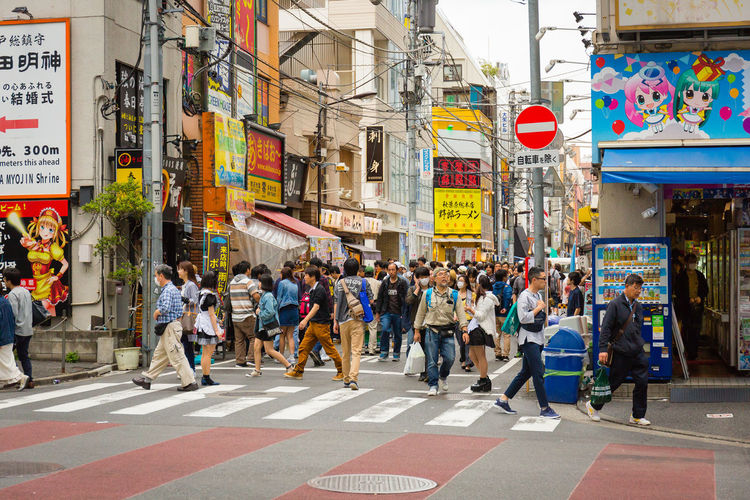 Bustle City Architecture Street Building Exterior Large Group Of People Crowd Group Of People Built Structure Sign Real People City Life Road Crosswalk Road Marking Crossing Walking Transportation Zebra Crossing City Street Pedestrian Outdoors Light The Traveler - 2015 EyeEm Awards The Street Photographer - 2019 EyeEm Awards Akihabara Japan Japan Photography Tokyo Urban City Life City Streetphotography Canon Canonphotography Signs Signage