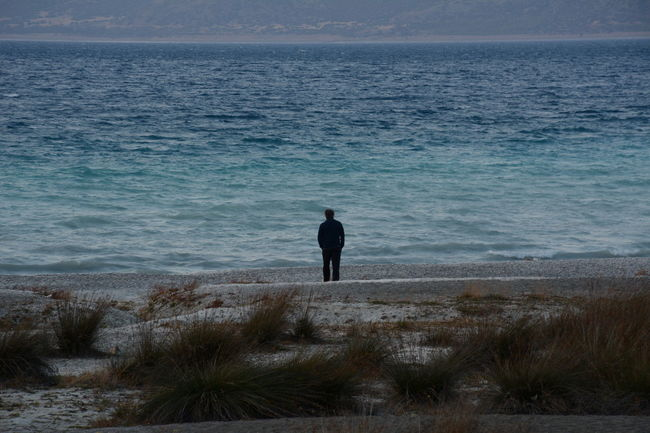In Salda Lake Turkey Loneliness Lonelyplanet Lost In The Landscape Nature Outdoors One Person Silhouette Water Adventure Day Men EyeEm Team Eye4photography  EyeEm Gallery Eye For Photography EyeEmBestPics Clear Sky Sky Tranquility Nature Landscape Illuminated Sea