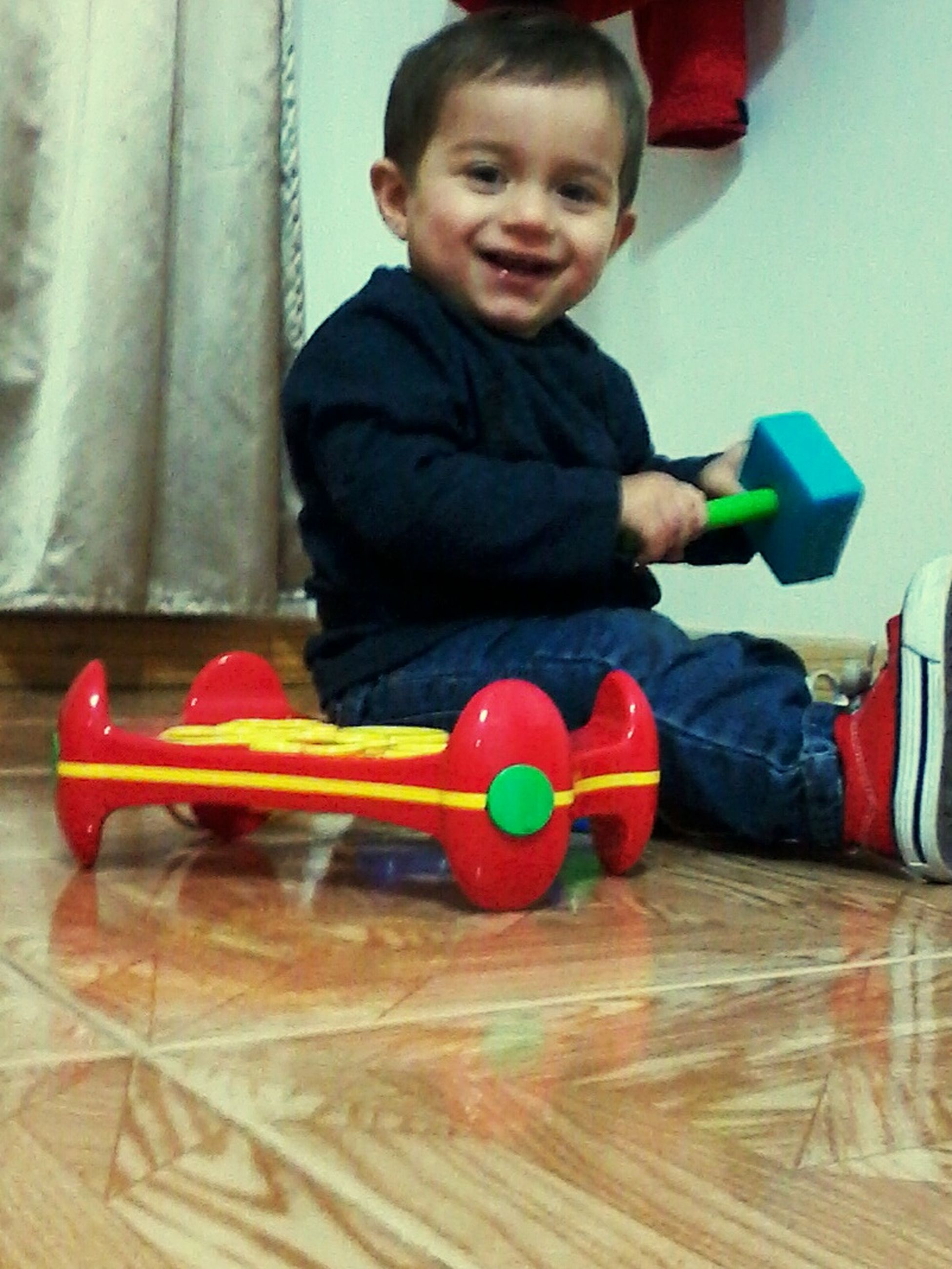 indoors, person, childhood, casual clothing, lifestyles, front view, looking at camera, sitting, portrait, leisure activity, elementary age, home interior, boys, cute, full length, table, innocence, holding