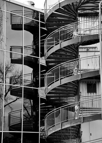 Blancoynegro Blanco Y Negro Architecture Berlin Photography Bnw_collection Bnwphotography Bnw_worldwide Blackandwhite Black & White Light And Shadow Reflection Mirrored Glass - Material Glass Art Architecture Steps And Staircases Spiral Staircase Built Structure Building Exterior Staircase No People Day
