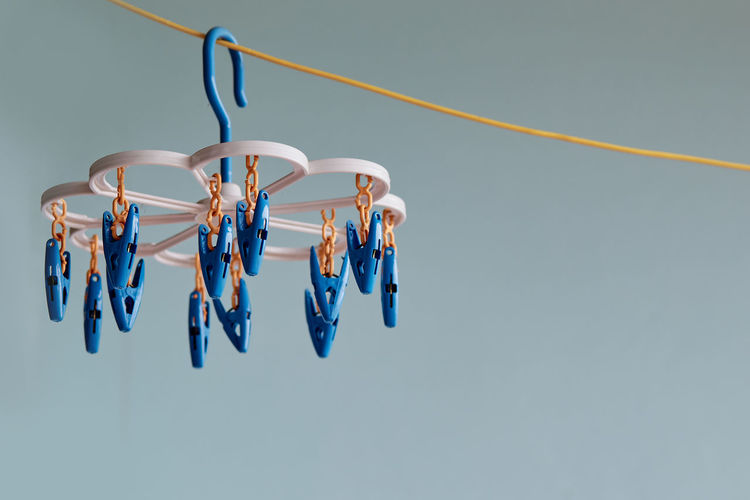 Low angle view of multi colored clothespins on clothesline