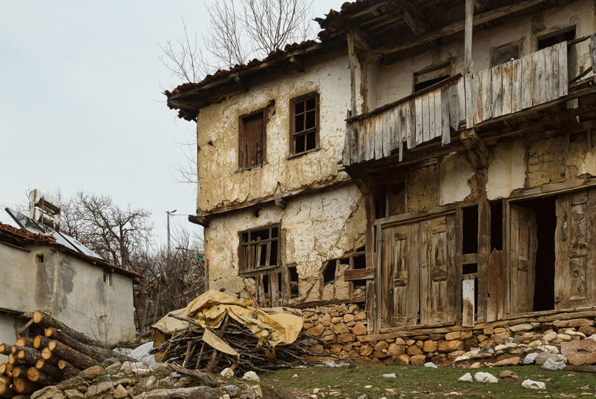 Old Village Home Abandoned Buildings Abandoned Places Architecture Balcony Building Exterior Built Structure Damaged Day Demolished Destruction Deterioration Fire Wood Firework - Man Made Object House Log Pile Logs No People Outdoors Residential Building Ruined Sky Weathered Window Wood - Material Wood Planks