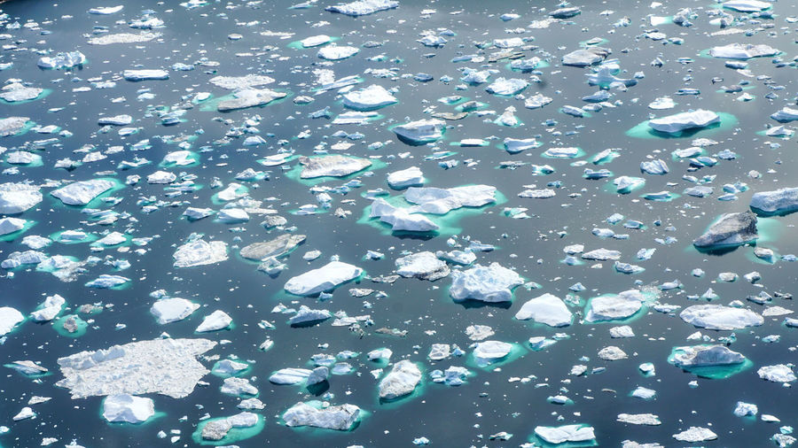 High angle view of ice floating on water
