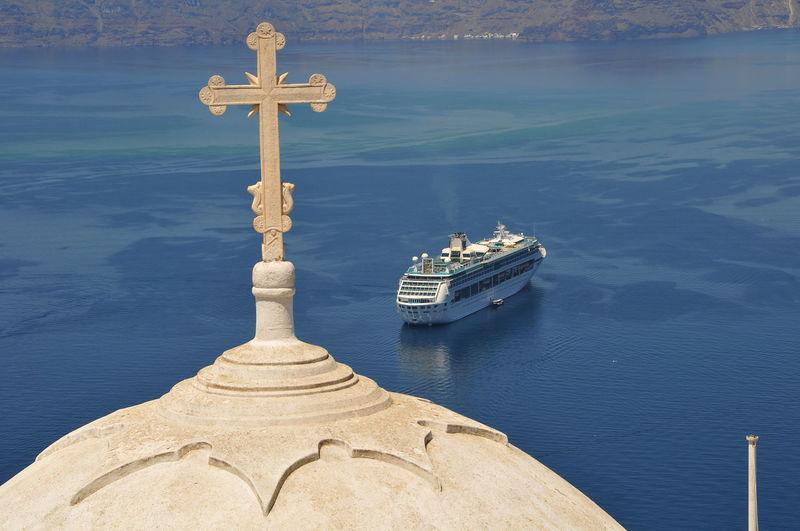cruising Santorini Aegean Cruise Cross Cruising Santorini Day Nautical Vessel No People Outdoors Religion Santorini Santorini, Greece Sea Sky Spirituality Statue Water