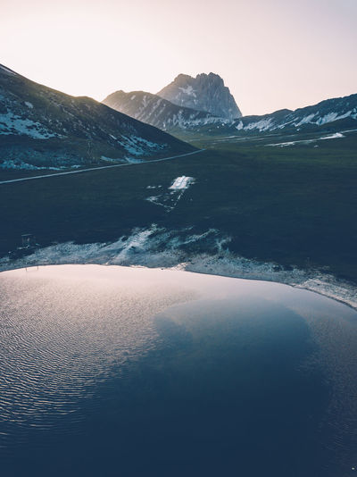 The Gran Sasso Mountain was there and no one wanted to be in an another place in that particular moment. Dronephotography DJI Mavic Pro DJI X Eyeem Mountain Sunset Sonyalpha The Great Outdoors - 2018 EyeEm Awards Mountain Snow Cold Temperature Water Winter Lake Sunset Snowcapped Mountain Frozen Pinaceae Mountain Peak Mountain Ridge Eastern Europe