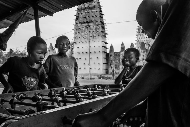Africa Black And White Blackandwhite Building Exterior Burkina Faso City Fun Kicker Outdoors Photo Of The Day Playing Games Real People Table Kicker Table Soccer The Street Photographer - 2017 EyeEm Awards Togethernes Togetherness Young Adult The Photojournalist EyeEmNewHere