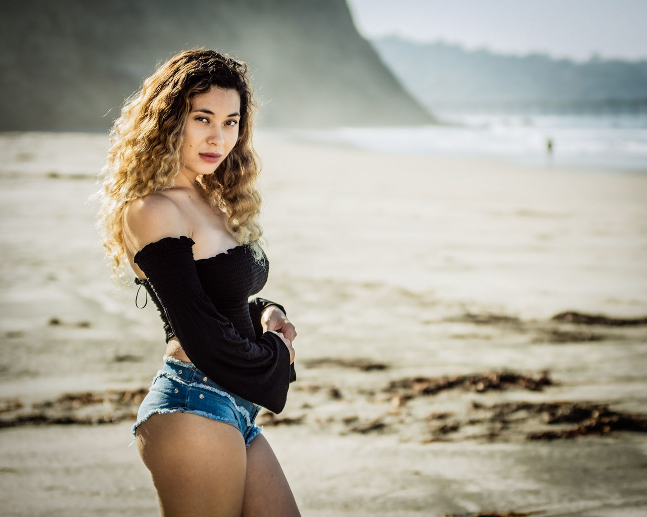 young adult, real people, young women, lifestyles, beautiful woman, focus on foreground, leisure activity, one person, sea, beach, standing, looking at camera, beauty, long hair, outdoors, nature, portrait, water, beauty in nature, day, sky