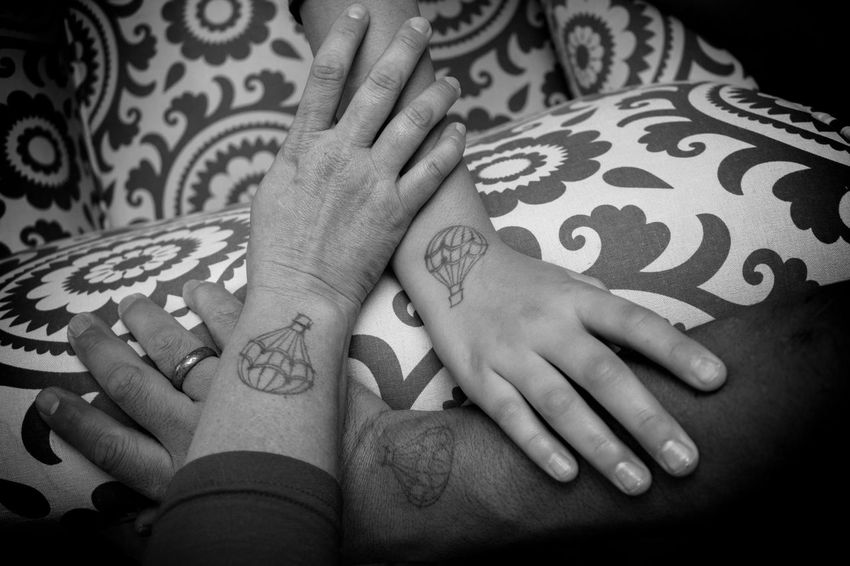 My Family's Hands with our hot air balloon stamps after a visit to a Hot Air Balloon Glow 3 Arizona Family Hot Air Baloon Human Body Part Human Finger Human Hand Indoors  Monochrome Real People Stamp Three Tucson Tucson Arizona  Women Man Ink Bond Bonding Strength Strong Digits Showcase: November
