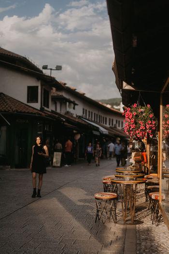 People walking on street against building