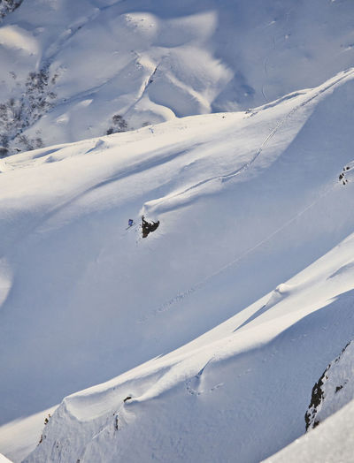 High angle view of people skiing on snow covered mountain