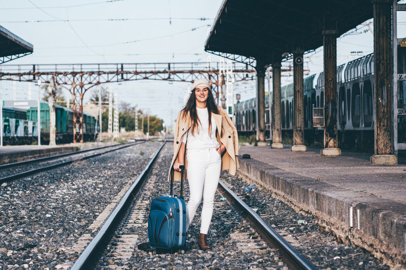 Portrait of young woman at railroad station