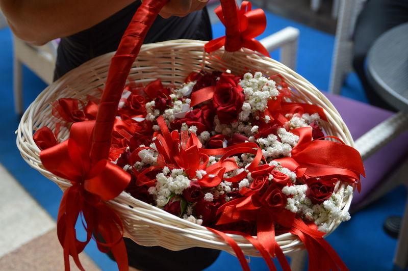 Midsection of woman holding basket full of decorations