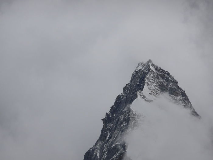 Low angle view of snowcapped mountain against sky ama dablam