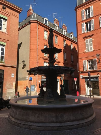 """Toulouse """"La Ville Rose- The pink city"""" La Ville Rose  The Pink City Fountain Square Toulouse.  Architecture Building Exterior Day"""