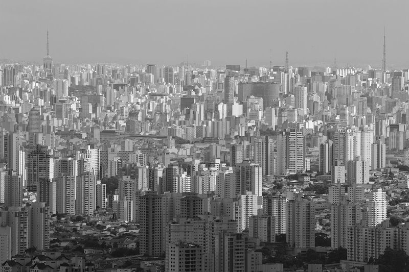Aerial view of modern buildings in city against clear sky