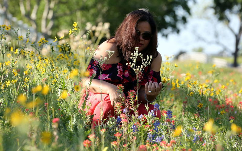 Roadside photo shoot Adult Beautiful Woman Beauty In Nature Day Field Flower Freshness Front View Grass Growth Happiness Leisure Activity Lifestyles Long Hair Love Yourself Nature One Person Outdoors Plant Real People Smiling Sunglasses Tree Yellow Young Adult Young Women