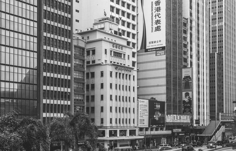 Tall buildings, Hong Kong Building Exterior Architecture Skyscraper Tram Stop City FUJIFILM X-T2 Black And White Monochrome Photography Hong Kong Monochrome Urban Skyline Architecture