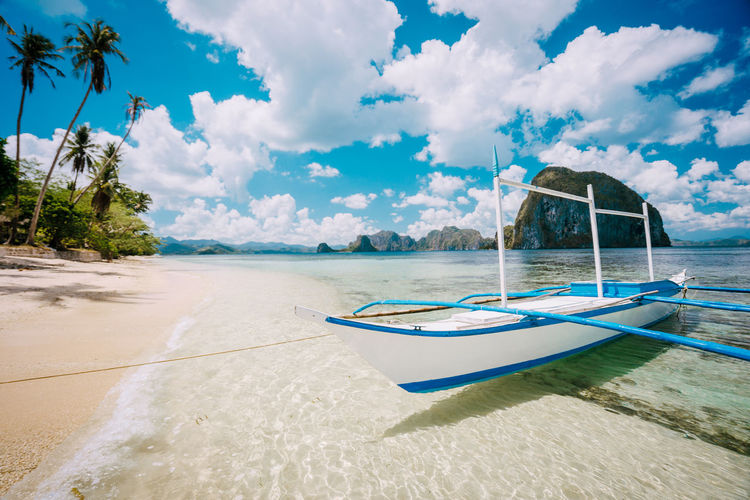 Impressive white cloudscape above picturesque sea shore with boat in El Nido, Palawan, Philippines. Wonderful nature. Nature Palawan Impressive Clouds Beach Blue Coastline Dream Getaway  Idyllic Island Lagoon Panoramic Landscape Romantic Ocean Palm Paradise Peace Philippines Relax Relaxation Sand Scenery Scenic Summertime Sea Shore Bounty Solitude Lonely Summer Traditional Travel Tree Tropical Tropics Turquoise Vacation Water ASIA Background Beautiful Boat Coast El-nido Escape Mountain Outdoor Seascape Sunny Tranquility Views Southeast Panorama Archipelago Bay Deserted Exotic Holidays Manila Natural Nobody Place