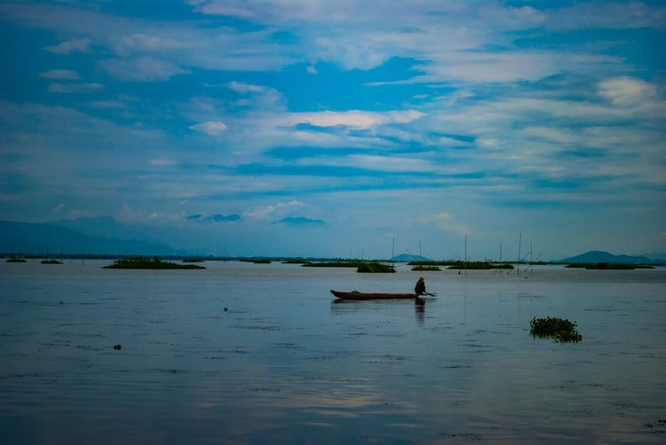 Beauty In Nature Boat Divine Beauty Horizon Over Water Lake View Loktak Lake Sky Tranquil Scene Transportation Water Waterfront The Photojournalist - 2017 EyeEm Awards