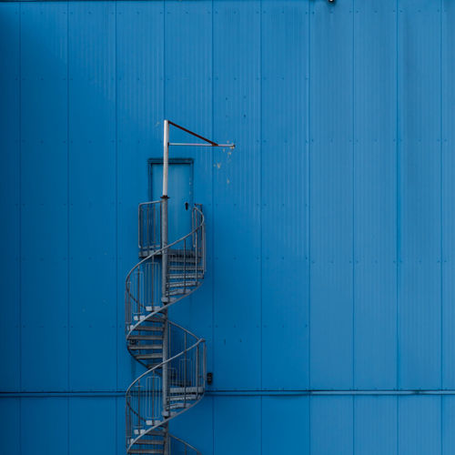Fire escape against blue wall