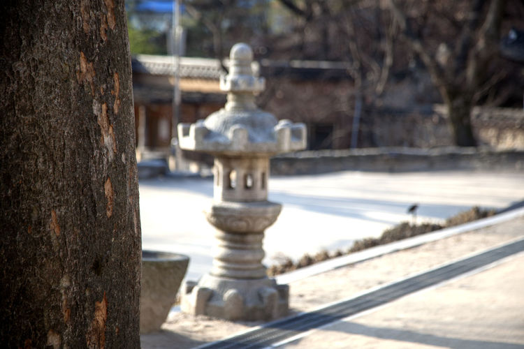 Animal Representation Art Art And Craft Buddhism Buddhist Temple Creativity Historic Human Representation Metal No People Old Old-fashioned Railing Religion Sculpture Selective Focus Silsangsa Spirituality Statue Stone Tower Wood Wooden