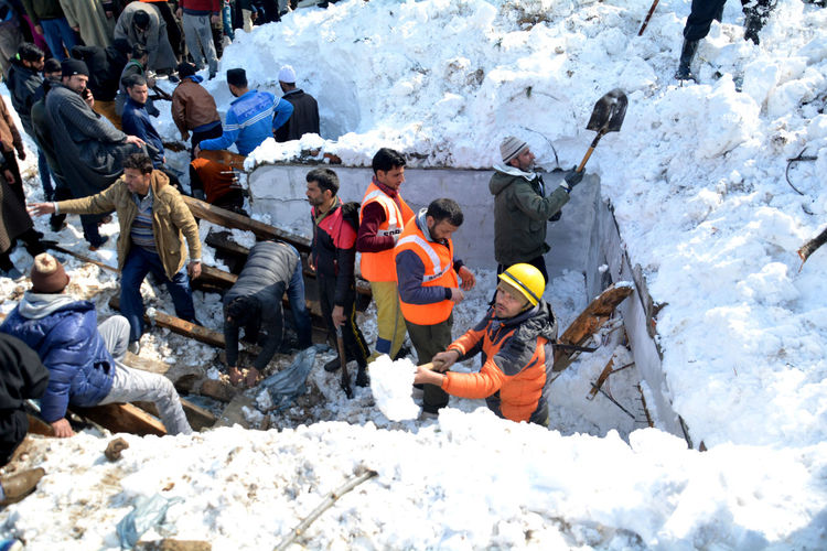 Rescuers work at the site of avalanche at Jawahar Tunel, some 90 kilometers south of Srinagar, the summer capital of Indian Kashmir, 08 February 2019. Seven persons died and three others were rescued alive from the site of an avalanche. Ten people were in snow after an avalanche hit a police post near Jawahar Tunnel on 07 February evening. Kashmir , India Srinagar Kashmir Kashmir Snow Resue Village Life Men Snow Cold Temperature Occupation Winter Protective Workwear Standing Togetherness