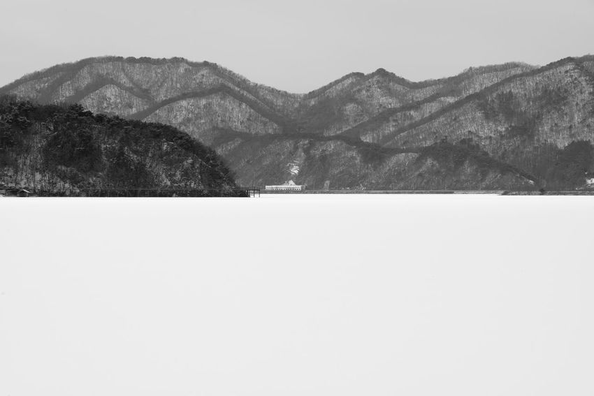 black and white image of snow-covered lake, Uiamho Lake in Chuncheon, Gangwondo, South Korea Black & White ChunCheon Cold Lake Cold Weather Gongjicheon Snow Land Uiamho Lake Winter Winter Landscape Beauty In Nature Black And White Blackandwhite Bw Clear Sky Cold Cold Temperature Day Landscape Mountain Mountain Range Nature No People Outdoors Scenics Sky Snow Snow-covered Snow-covered Lake Tranquil Scene Tranquility Travel Destinations Winter Winter Lake Winter Land Winter Time
