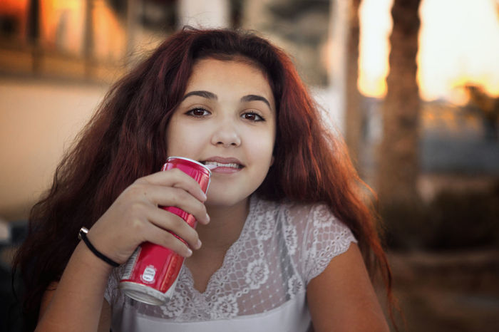 Drinking Soda  Sipping Sunset Drink Beautiful Woman Brown Hair Drink Drinking Focus On Foreground Food And Drink Front View Glass Hair Hairstyle Happiness Holding Long Hair Looking At Camera One Person Portrait Refreshment Sipping Cola Sipping Drink Sipping Soda Smiling Srinking With Straw Women Young Adult Young Girl Young Women