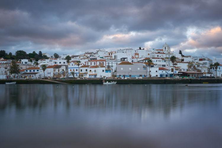 Ferragudo city beach landscape at sunrise in algarve, portugal