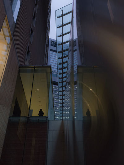 Tokyo 2016 Evening Light Japan Japan Photography Lost In The Landscape Reflection Tokyo Tokyo Street Photography Architecture Building Exterior Built Structure City Evening Low Angle View Mirror Reflection Modern Skyscraper Streetphotography Window The Graphic City
