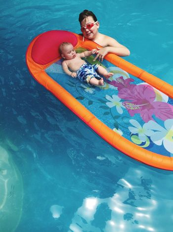 Grandbaby and Son Pool Floating On Water Relaxing