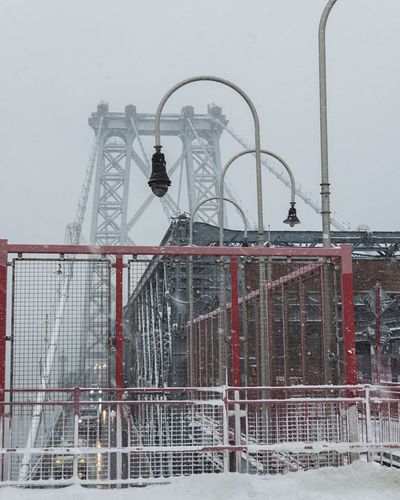 Williamsburg bridge against sky during winter