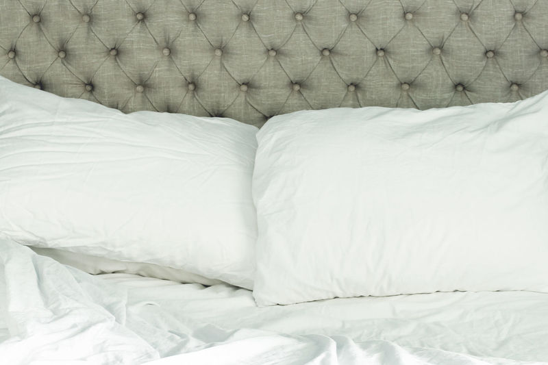 Sleep Bed Bedroom Close-up Comfortable Day Headboard Indoors  Interior Design Linen Morning No People Pillow Quilt Rumpled Sheet Sleep Tranquility Tufted Unmade White