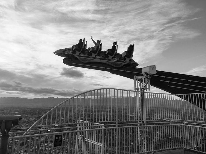 People enjoying x-scream thrill ride at stratosphere las vegas hotel against sky