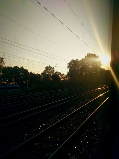 Morning glow Railroad Track Transportation Sun Rail Transportation Sunlight Sky Sunbeam The Way Forward Railway Track Bright Düsseldorf Stadtbahn Mobilephotography Morning Sky No People Sunlight