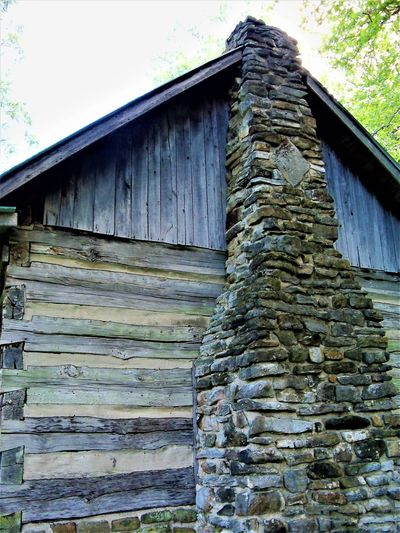 The Cabin Architecture Chimney Chimneys Historical Building History Through The Lens  India Log Cabin Roof USA Wood Cabin Cabin In The Woods Cabin Life Cabins  Country Life Historic Historical History History Architecture Log Cabin Exterior Log Cabins Logs Stone Wood - Material Wooden
