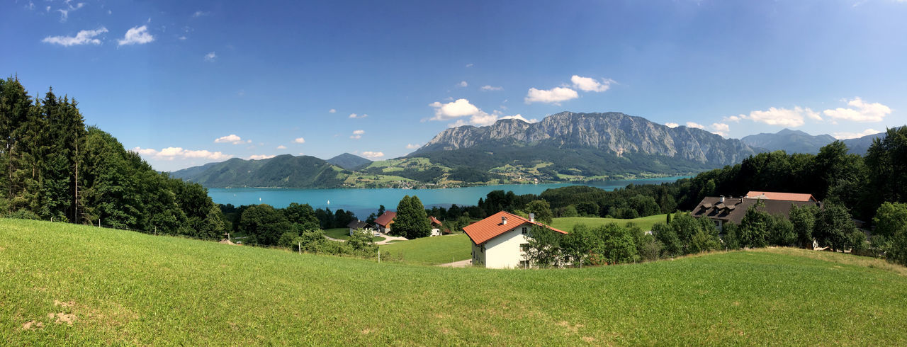 Panoramic view of attersee by mountains against sky