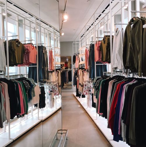 clothes store Retail  Shopping Store Clothing Store Clothing For Sale Retail Display Indoors  Large Group Of Objects Business Sale Fashion Boutique Variation Choice No People Abundance Hanging Textile Collection