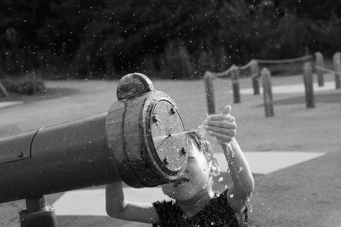 Playing Water Leisure Activity Human Body Part One Person Outdoors Human Hand Childhood Lifestyles Outdoor Water Play Children Children Photography One Boy Only Boy Playing Water Pistol Water Gun Playground Children Playing Day Black And White Black And White Photography The Portraitist - 2018 EyeEm Awards 10 #urbanana: The Urban Playground