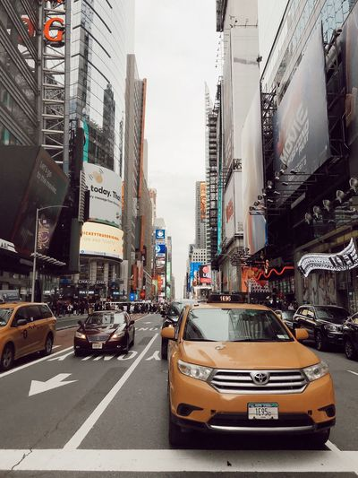 Yellow Taxi Taxi New York City City Mode Of Transportation Car Transportation Motor Vehicle Architecture Building Exterior Built Structure Sign Land Vehicle City Street Street Text Office Building Exterior Communication Road City Life Incidental People Western Script Road Marking