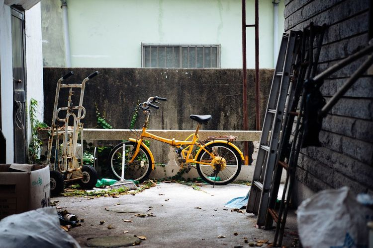 Bicycle Land Vehicle Architecture Transportation Built Structure No People Building Exterior Day Mode Of Transportation Building Stationary Abandoned Outdoors Damaged Obsolete Old Door Parking Wall Metal Wheel Garage