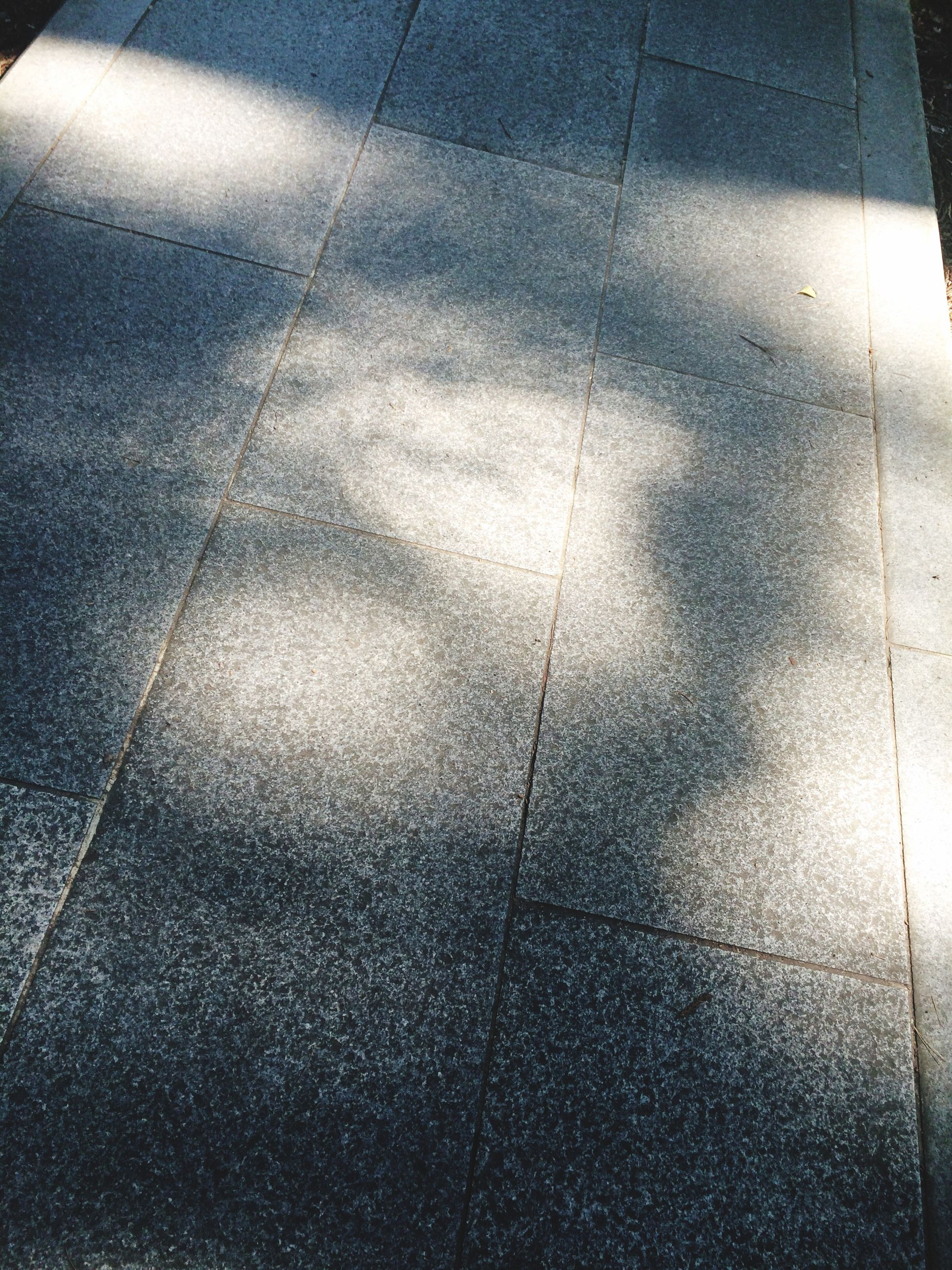 high angle view, shadow, street, sunlight, road marking, road, sidewalk, transportation, tiled floor, asphalt, paving stone, flooring, the way forward, day, footpath, outdoors, cobblestone, pavement, low section, pattern