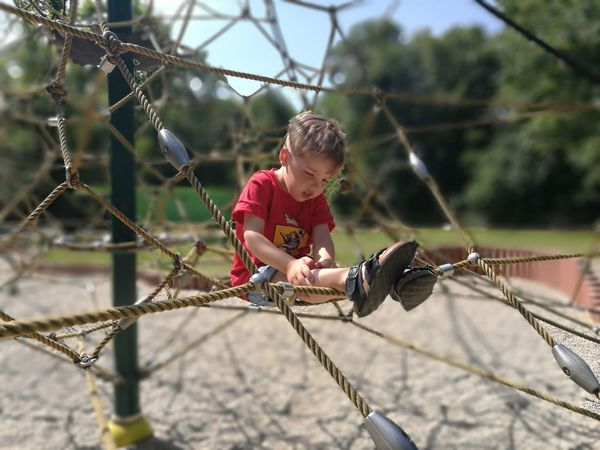 Childhood Child Children Only One Boy Only Casual Clothing Males  One Person Outdoors Playground Playing Sport Nature Kletterpark Klettergerüst Spielplatz