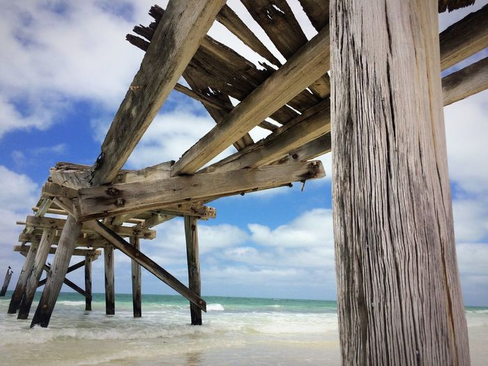 Beach Photography EyeEmNewHere Still Standing Strong Low Tide Revelations No People Old Jetty Wood Old Pier Posts View From Below