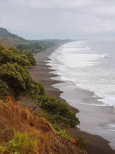 Costa Rica Playa Hermosa Wave Water Sea Beach Sand Water's Edge High Angle View Sky Horizon Over Water Landscape