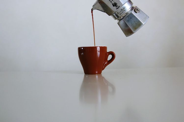 Coffee Being Poured In Cup On Table