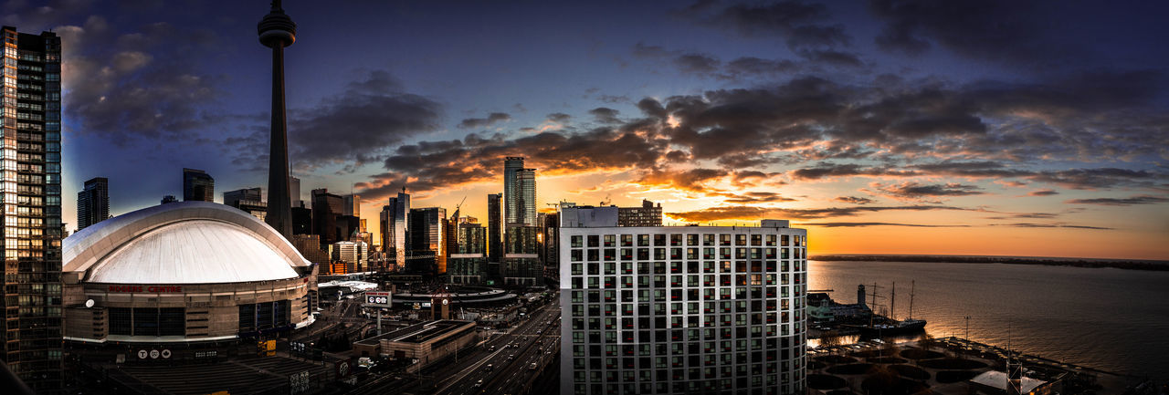 Cityscape against sky at sunset